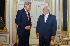 U.S. Secretary of State John Kerry stands with Foreign Minister Javad Zarif of Iran in Vienna, Austria, on November 23, 2014, before the two begin a one-on-one meeting amid broader negotiations about the future of Iran's nuclear program. [State Department photo/ Public Domain]