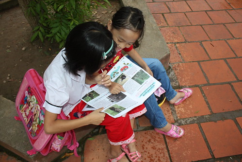 Kids reading bear magazine