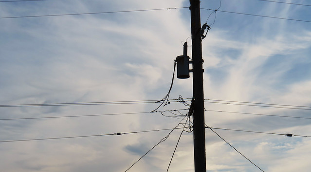 telephone pole, tranformer and wires against high wispy cloud sky; The Sunset, San Francisco; January 25, 2015