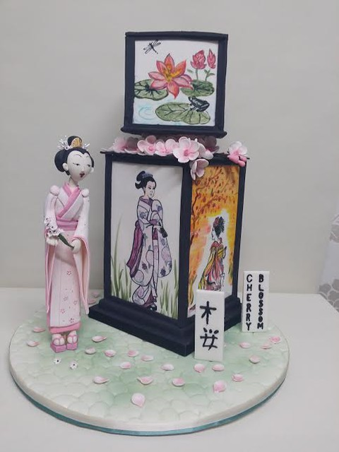 2 Tiered 4 Panelled Hand Painted, Japanese Inspired Cake with a Hand Modelled Japanese Lady by Sue Bertuch of Sue's Sweet Delights