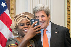 U.S. Secretary of State John Kerry takes a selfie with an outstanding individual who is fighting to end human trafficking at the Annual Meeting of the President's Interagency Task Force to Monitor and Combat Trafficking in Persons (PITF) at the White House in Washington, D.C., on October 24, 2016. [State Department photo/ Public Domain]