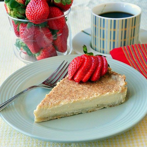British Custard Tart - a.k.a Egg Custard Pie. With a bit of an eggnog flavour, this would make an ideal Christmas dessert. A perfectly baked custard tart with a velvety smooth filling and a great crust is a delicious British tradition. This recipe shows h