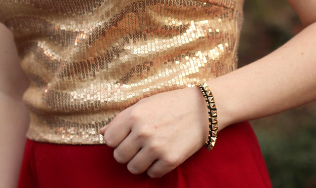 Spiked Bracelet and a Gold Sequined Shirt