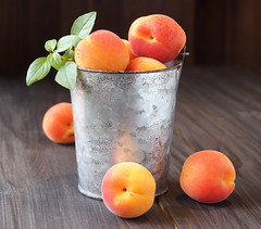 Juicy fresh peaches in a bucket