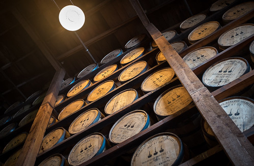 Bourbon barrels aging at Woodford Reserve. 1/15 @ f2.0, ISO 400.