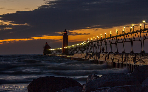 sunset usa lighthouse water clouds lights evening pier rocks december waves unitedstates dusk michigan lakemichigan catwalk grandhaven 2014 westmichigan kevinpovenz