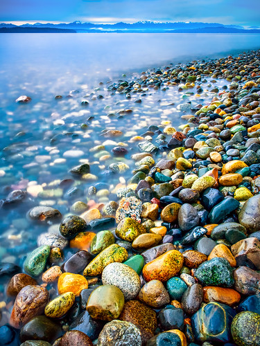 rocks stones rocky coast shore coastline shoreline west seattle puget sound washington pacific northwest olympic mountains water long exposure color colorful multicolored kwphotos kwphotoscom kyle wasielewski landscape seascape lincoln park