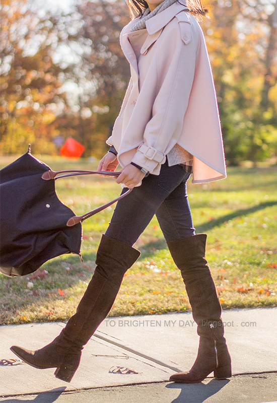 pink trench cape, gray sweater, navy plaid shirt, brown suede over the knee boots