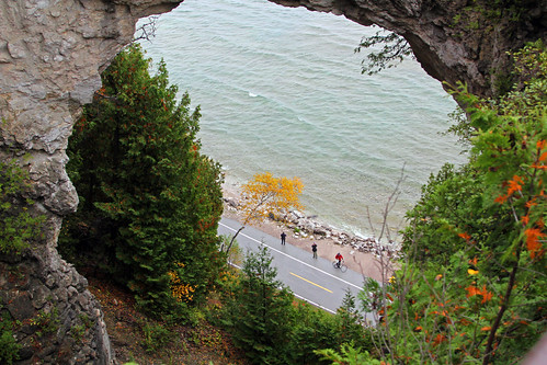 autumn trees lake fall tourism beach scale bicycle arch michigan fallcolors tourists cedar limestone mackinacisland rockybeach lakehuron autumncolor bolders whitecedar naturalarch archrock limestonerock limestonearch jannagal jannagalski