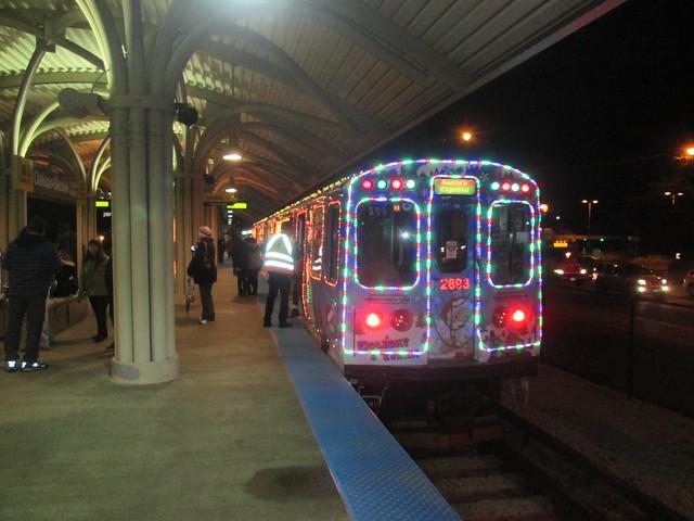 Northwest-bound Yellow Line Holiday Train stops at Oakton-Skokie station (evening)