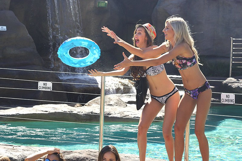 models playing by the pool