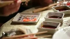 Eating sushi. Close up.