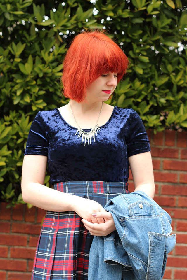 Bright Red Hair, Silver Spiked Necklace, and a Blue Crushed Velvet Crop Top