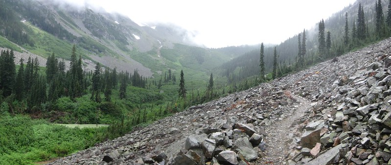 Panorama shot upward toward Glacier Pass on the PCT in the mist and rain