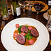 Roast venison loin from Middlewood Farm Breconshire, prosciutto beetroot and goat\'s cheese gnocchi, kale and creamed porcini mushroom jus