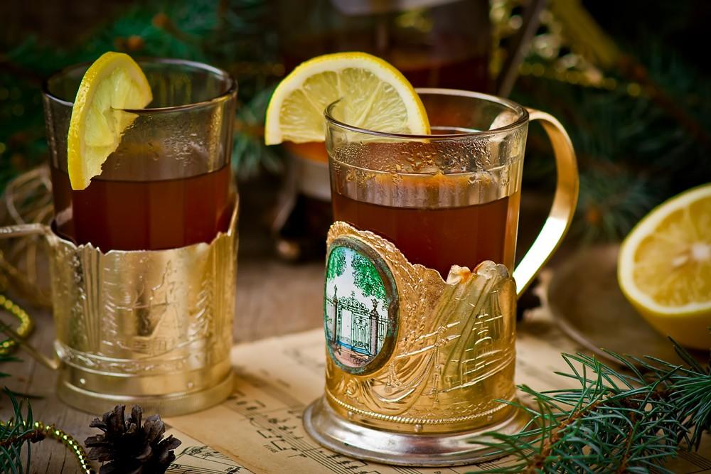 hot black tea with a lemon in vintage glasses