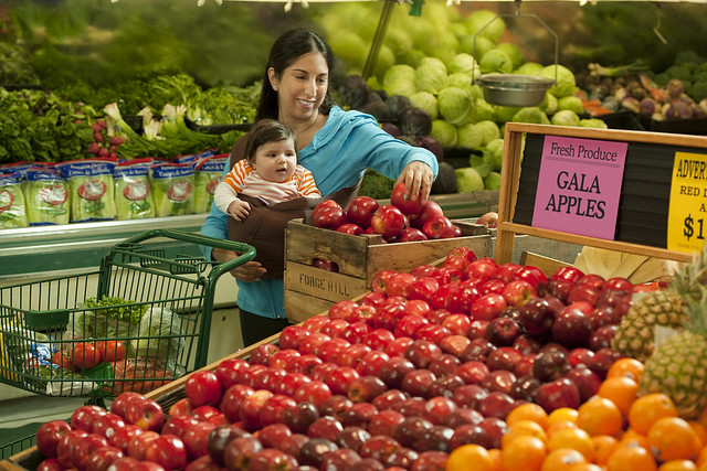 Woman with child at supermarket