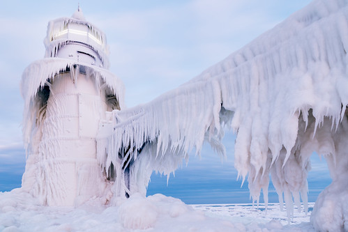 travel winter light sea sky lighthouse white snow cold building ice nature water weather clouds sunrise outdoors pier frozen midwest unitedstates michigan scenic stjoseph landmark structure greatlakes beacon saintjoseph hoth lakelake echobase johncrouch stjosephlighthouse johncrouchphotography extremeice copyright2014johncrouch