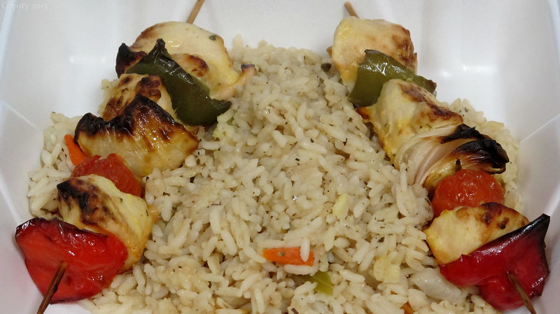 Marinated chicken kababs on rice pilaf
