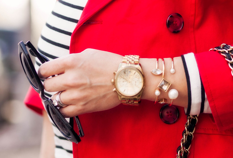 https://cuteandlittle.com | petite fashion blog | maternity | arm party, bracelet stack, ann taylor modern classic skinny bangle set, michael kors boyfriend gold watch, red trench, black white striped turtleneck