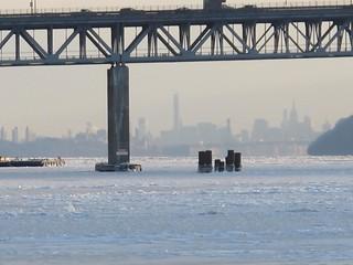 Frozen Hudson River and the Manhattan skyline under the Tappan Zee Bridge