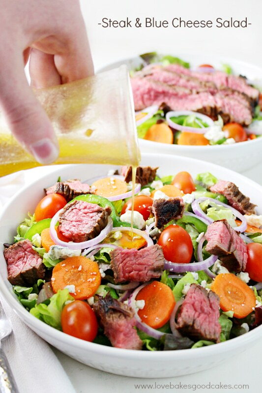 Steak and Blue Cheese Salad in a bowl with dressing.
