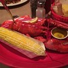 Steamed lobster with corn on the cob.