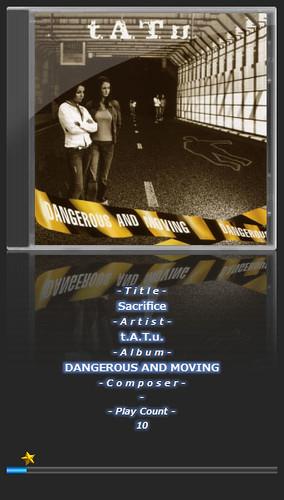 """tatu-1 音楽再生ソフトウェアのfoobar2000のスクリーンショット画像。 """"t.A.T.u"""" のアルバムである """"DANGEROUS AND MOVING"""" のアートワークが表示されている。"""