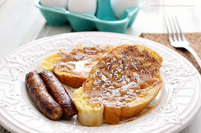 Salted Caramel French Toast with sausage links and a fork.