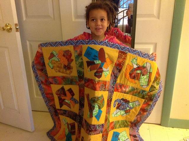 Z makes a quilt for her baby sibling