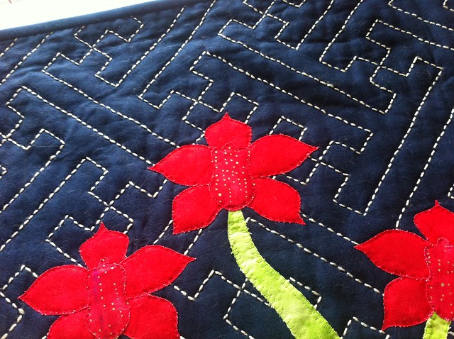 Sashiko and orchids wall hanging quilt. I used a spotted fabric for the lip.