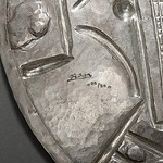Picasso silver medal signature closeup