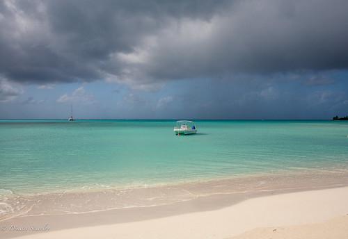 seascape storm beach rain boats paradise longisland resort santamaria thebahamas
