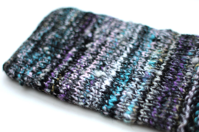 Knitted Kindle cover in handspun yarn