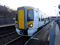 Thameslink Electrostar 387119 pauses briefly at Flitwick Station