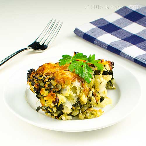 Kale and Cabbage Gratin on plate, with parsley garnish