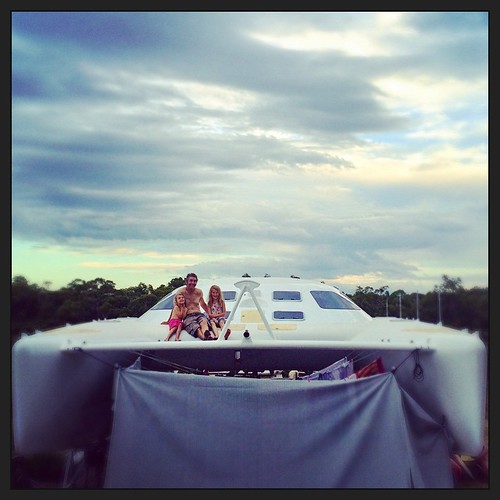 057/365 • waiting to see if the clouds bring rain • #057_2015 #catamaran #liveaboard #4yo #7yo #M #nearlybedtime #trampolines #blindbight #carsandboatneedawash