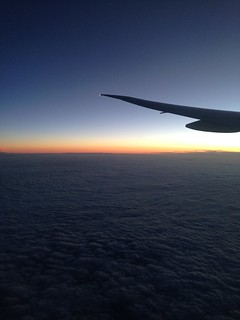 Sunset over the clouds en route to Hamburg from Dubai with Emirates in a Boeing 777-300ER