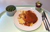 Turkey roast in sherry sauce with potato gratin / Putenrollbraten in Sherrysauce mit Kartoffelgratin
