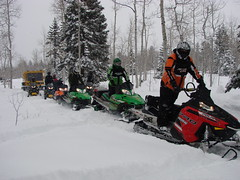 sled(0.0), auto racing(1.0), racing(1.0), winter sport(1.0), winter(1.0), vehicle(1.0), sports(1.0), snow(1.0), motorsport(1.0), snowmobile(1.0), land vehicle(1.0),