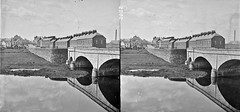 """""""Bridge of three arches over river in foreground"""" is Portadown"""