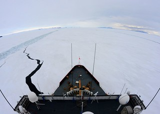 The Coast Guard Cutter Polar Star, a heavy icebreaker homeported in Seattle, breaks a parallel channel in the ice beside a previous channel near the National Science Foundation's McMurdo Station, Antarctica, Jan. 15, 2015. As the area of broken ice widens, southerly winds will push the ice out to sea, allowing supply vessels to deliver cargo to McMurdo Station. (U.S. Coast Guard photo by Petty Officer 1st Class George Degener)