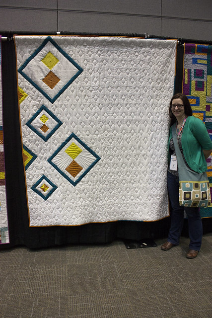 Quilt Con Charity Quilts_Rebekah with the DAMQG quilt