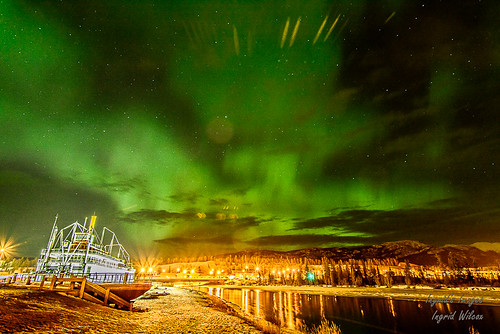 A gentle aurora over Yukon River and the S.S. Klondike