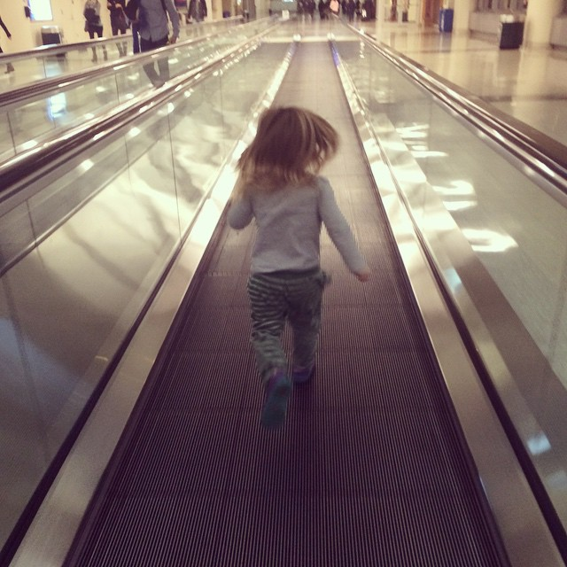 Now burning off crazy overtired energy by running up and down the moving walkways. #winterbreak2014 #midwayairport