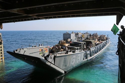 U.S. 5TH FLEET AREA OF RESPONSIBILITY - A landing craft utility (LCU) exits the well deck of the amphibious dock landing ship USS Comstock (LSD 45) to transport Marines and Sailors assigned to the 11th Marine Expeditionary Unit (MEU) and Comstock ashore in support of exercise Red Reef 15.