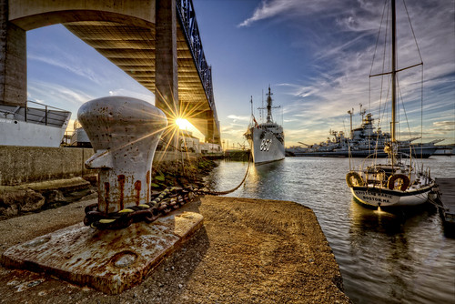 fallriver massachusetts unitedstates battleshipcove sunset bragabridge battleship museum sunburst boat tauntonriver somerset marine navy floatingmuseum docked sea destroyer ussmassachusetts submarine newengland nikon d800e frankcgrace trigphotography yextmassachusetts