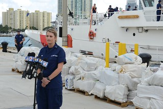 Lt. j.g. Breanna Hite, operations officer of the Coast Guard Cutter Paul Clark, responds to questions from local media for a drug offload at Coast Guard Sector Miami Dec. 31, 2014. The crew of the Paul Clark interdicted a go-fast vessel south of Jamaica carrying 103 bales of marijuana worth an estimated $3.7 million wholesale value. U.S. Coast Guard photo by Petty Officer 3rd Class Mark Barney.