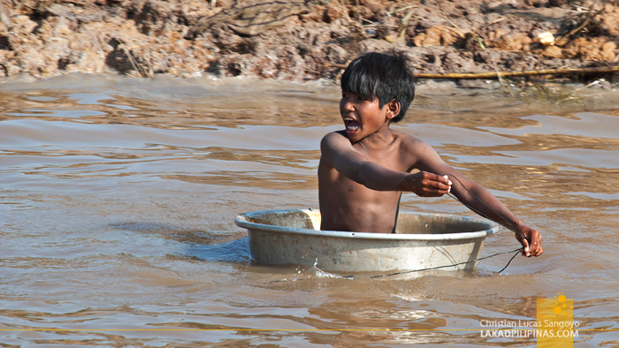 Kid Playing at the Floating Village of Kompong Phluk in Siem Reap