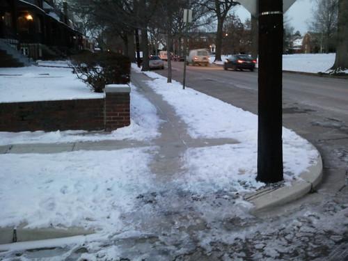 Shoveling a lane in the sidewalk, unshovelled corners